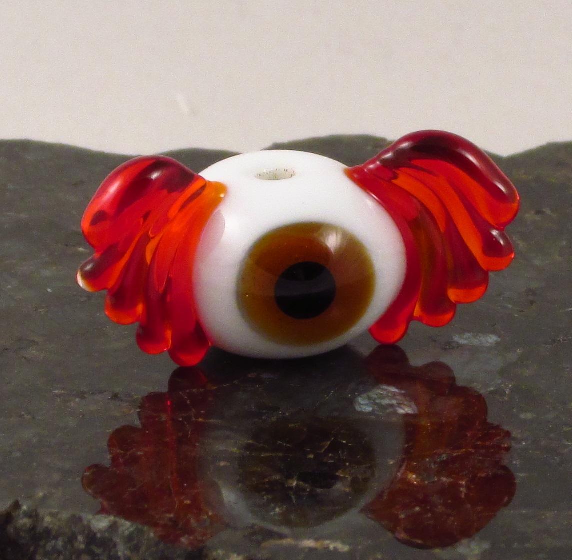 Brown & Red Flying Eyeball